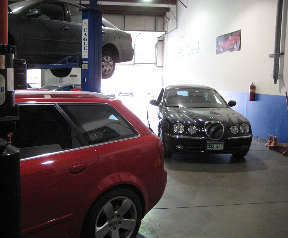 Cew different cars in the auto shop