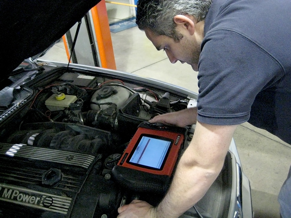 Car Mechanic Matt Osterlund diagnosing car issues